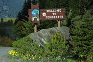 Sign on highway 99 welcoming visitors driving North from Whistler