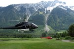 Heli in for a round of golf at Big Sky Golf Course